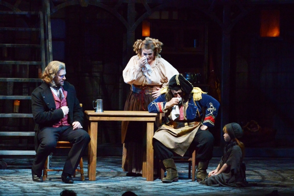 Valjean (Gregg Goodbrod), left, consults with Mme. Thenardier (Margot Moreland) and Thenardier (Richard Vida) about little Cosette (Sofia Dow)