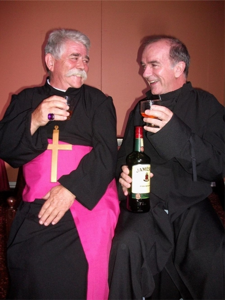 Archbishop Monticello (Rex Gray, left) and Father Costello (Noel O'Neill - also writer and director of the play) share a liquid blessing