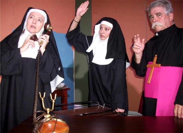 Archbishop Monticello (Rex Gray, right) worries about the money-making schemes devised by Sister Marilyn (Julia Trefeli, left) and Sister Vinnie (Valerie Dragojevic)