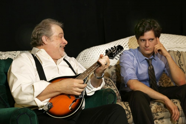 Frank (Scott Holmes) Entertains his grandson Nick (Louis Crespo) with his newly acquired mandolin.