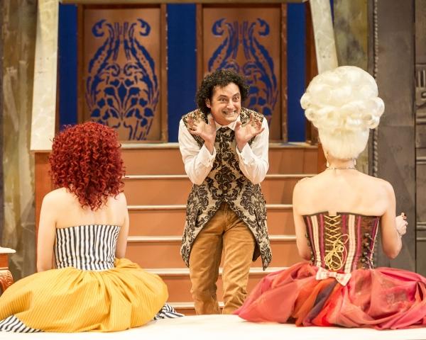 Angela Sauer (Suzanne) and Elyse Mirto (Countess Almaviva) look on as Jeremy Guskin (Figaro) schemes.