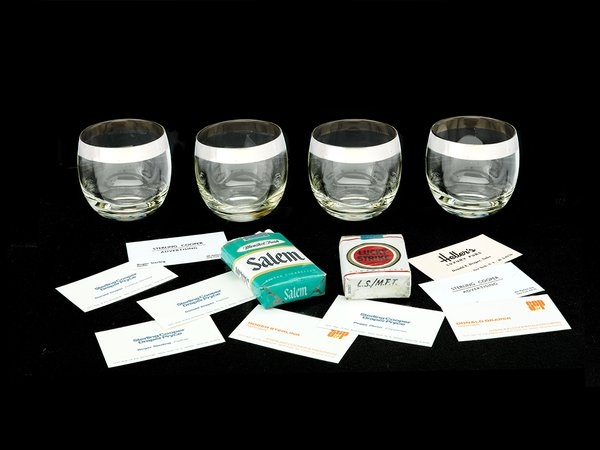 Glasses from Don Draper''s bar cart with Draper''s business cards and Lucky Strikes (National Museum of American History)