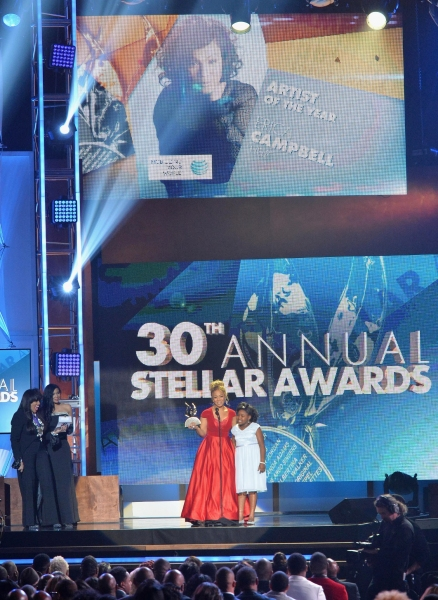 Singer Erica Campbell accepts an award onstage