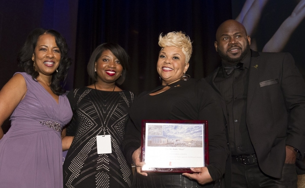 St. Jude Radio Cares Advisory Council member Monica Bacon and St. Jude rep Carmen Triplett-Watson present Tamela and David Mann with the St. Jude Star Award at the eOne Music post-Stellars Award Celebration.