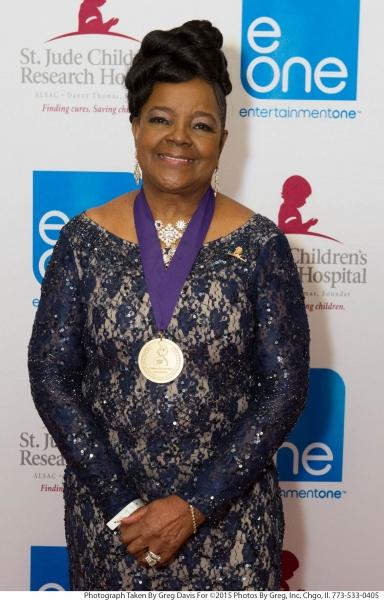 Gospel legend Pastor Shirley Caesar wears her special Stellar Honors medallion, at the eOne Music post-Stellars Award Celebration.