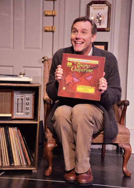 A lover of musical theatre, the Man in the Chair (David Schmittou) introduces the audience to the recording of his favorite: The Drowsy Chaperone, and the show comes to life on the stage.