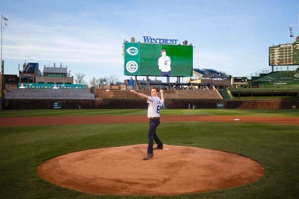 THE BOOK OF MORMON star David Larsen (Elder Price) throws out the Chicago Cubs Ceremonial First Pitch on April 13, 2015.
