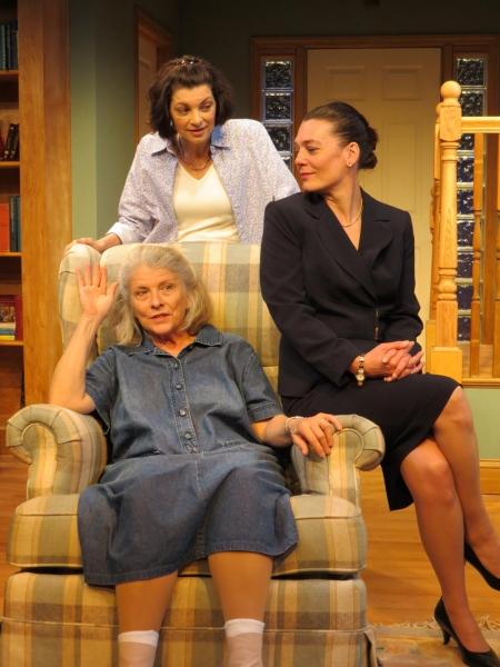 Marnie Andrews (seated), Corey Tazmania (dark suit), Dana Benningfield (standing behind chair).