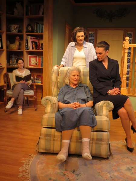 Marnie Andrews (seated), Corey Tazmania (dark suit), Dana Benningfield (standing behind chair), Jenny Vallancourt (background, seated)