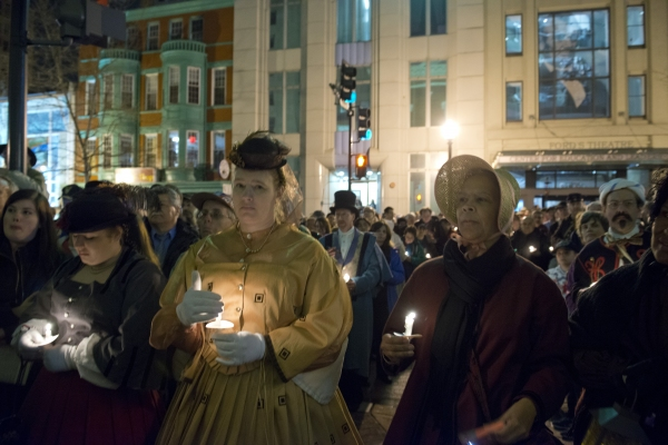 Crowds gather on Tenth Street NW outside of Ford's Theatre to honor Abraham Lincoln with a candlelight vigil on the night of April 14, 2015.