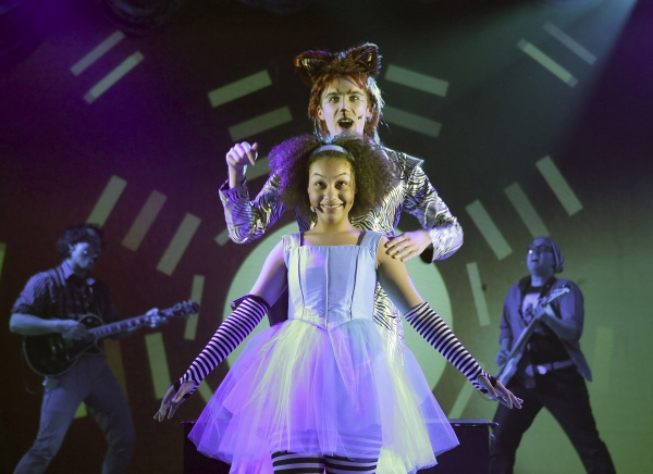 Ariana Burks is Alice and Andrew Mueller plays the glam rocker Cheshire Cat