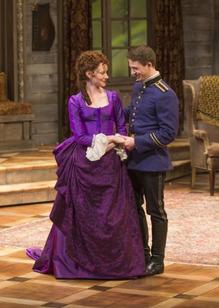 Wrenn Schmidt as Raina Petkoff and Zach Appelman as Captain Bluntschli