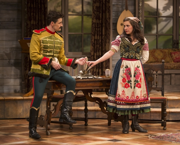 Enver Gjokaj as Major Sergius Saranoff and Sofiya Akilova as Louka