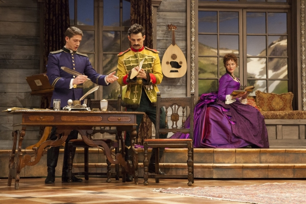 Zach Appelman as Captain Bluntschli, Enver Gjokaj as Major Sergius Saranoff, and Wrenn Schmidt as Raina Petkoff