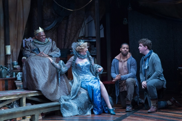 Claudius (Craig Wallace) and Gertrude (Kimberly Schraf) share a laugh with a bewildered Rosencrantz (Romell Witherspoon) and Guildenstern (Adam Wesley Brown, far right).