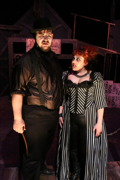 Mr. Peachum (Zachary Allen Farmer) and Mrs. Peachum (Sarah Porter) sing the ''Instead Of Song''
