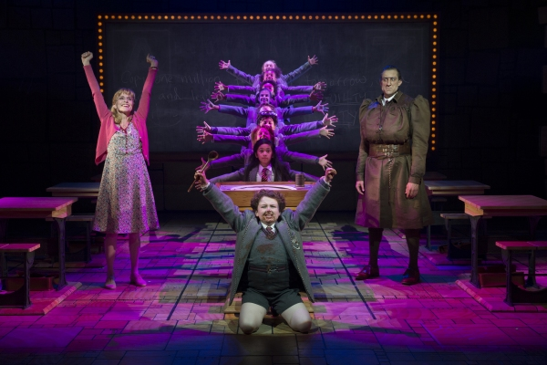 Jennifer Blood (L), Evan Gray (front center), Bryce Ryness (R), Gabby Gutierrez (center middle) and the Company of MATILDA THE MUSICAL First National Tour