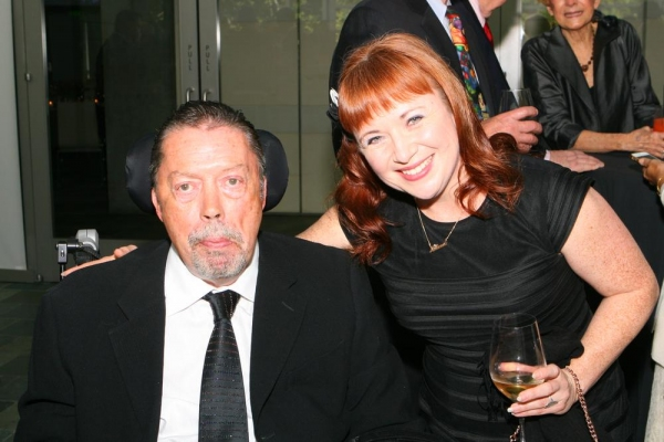 Tim Curry and Aileen Quinn
