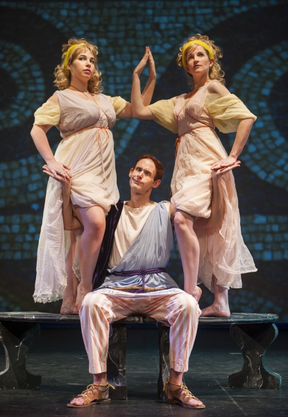 Pseudolus, played by Tomas Theriot (center) has a bit of fun with the Gemini twins Sara-Grace Kelly (left) and Cami Jackson (right).