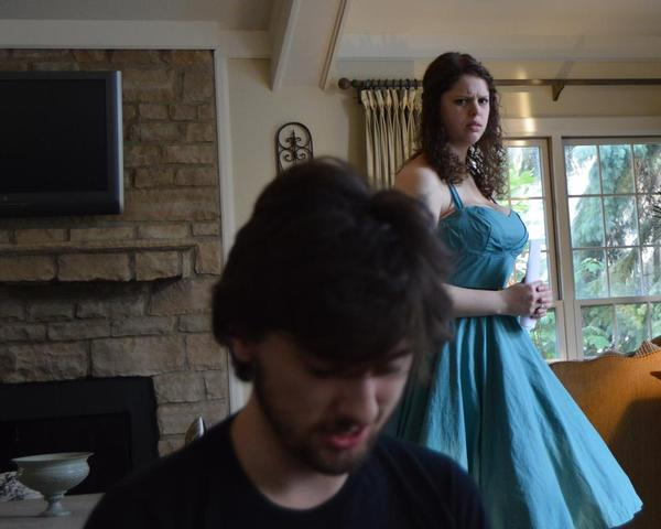 Rachel Marschner (Ophelia) looks on, concerned, as Jack Miller (Hamlet) seems to be pondering suicide in Act III of William Shakespeare''s Hamlet, being presented June 25-27, 2015 at the Abbey Theater of Dublin by CPC Theatrical.