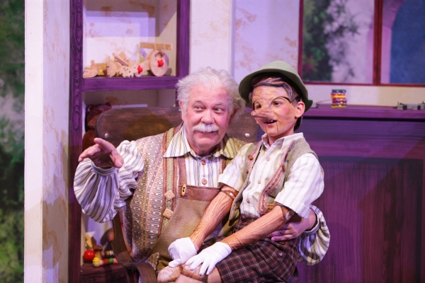 Geppetto (Nicholas F. Saverine) gets to know his new son Pinocchio (Topher Cundith).