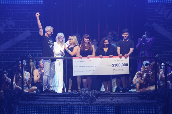 Presenting sponsor MAC VIVA Glam delivered a $300,000 check presented by Jennifer Balbier with Jerry Mitchell and Judith Light. Photo by Monica Simoes.