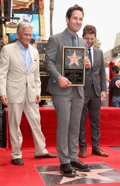 Paul Rudd poses with actors Michael Douglas and Adam Scott Photo