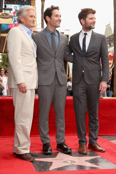 Paul Rudd poses with actors Michael Douglas and Adam Scott