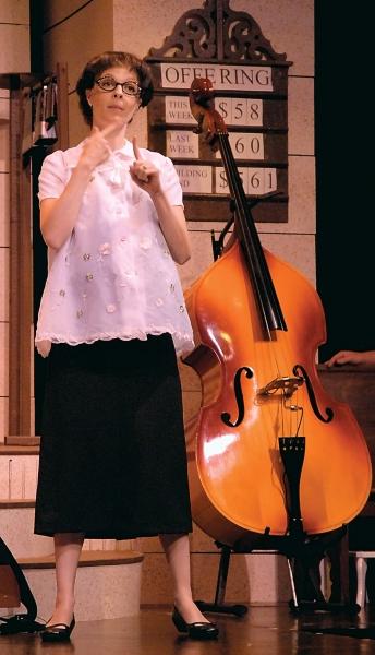Sarah Hund as June Sanders