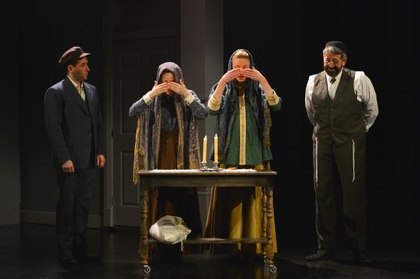 Vincenzo (Zachary Prince) observes as Sarah (Megan McGinnis), Chaya (Sharon Rietkerk), and their father Isaac (Rolf Saxon) say shabbos prayers