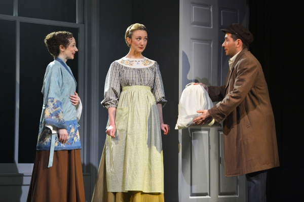 Sarah (Megan McGinnis) and Chaya (Sharon Rietkerk) take sewing work from Vincenzo (Zachary Prince), a secret admirer of Sarah