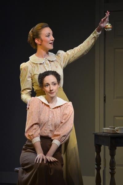 Chaya (Sharon Rietkerk, back) brings home an ornament to cheer up Sarah (Megan McGinnis, front)