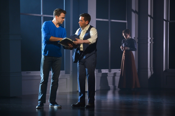 Brian (Ross Lekites) explains the connection they share with the Triangle Shirtwaist Factory to Ben (Zachary Prince) as a vision of Sarah (Megan McGinnis) lingers in the background