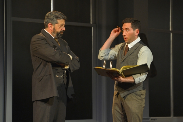 Boss (Rolf Saxon) makes sure Vincenzo (Zachary Prince) is meeting his quotas in the Triangle Shirtwaist Factory