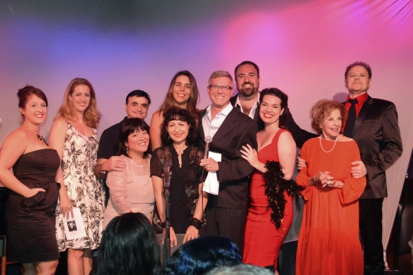 front row: Ann Harada, Janice Hall, host William V Madison, Hanna Burke, Joan Copeland. Back: Rosa Betancourt, Minda Larsen, Lawrence Leritz, Julie Feltman, Adam B. Shapiro, Walter Willison. Not pictured but also in the cast: Sarah Rice, Steve Ross and Mi