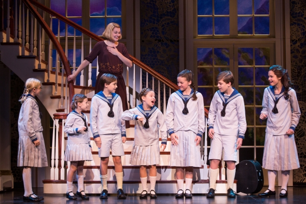 Kerstin Anderson as Maria Rainer with the von Trapp children: Svea Johnson who plays Brigitta, Audrey Bennett (Gretl), Quinn Erickson (Kurt), Mackenzie Currie (Marta), Maria Knasel (Louisa), Erich Schuett (Friedrich) and Paige Silvester (Liesl).