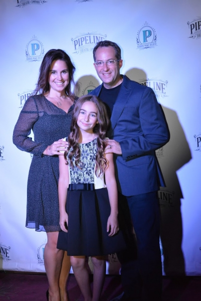 Tahlia Ellie (center) with her mother and father, Rebecca and Mark Bernstein Photo