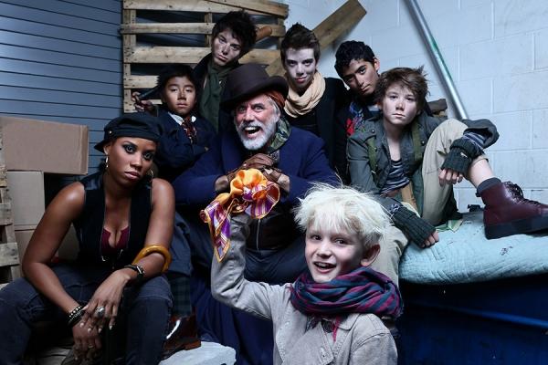 Jake Heston Miller as Oliver (bottom center) with Eleasha Gamble as Nancy, Jeff McCarthy as Fagin and members of Fagin''s gang