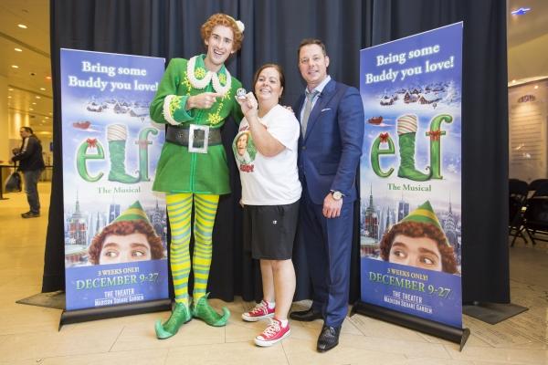 Buddy The Elf, Jeanette Perkins, Snow Globe Challenge winner and John Foxx, WPLJ