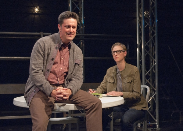 Ensemble members Tim Decker (left) and Kelli Simpkins portray a grieving father and a narrator listening to his story
