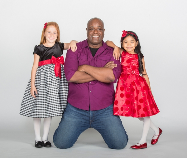 J. Bernard Calloway stars as The Grinch and (from left) Taylor Coleman and Mikee Castillo as Cindy-Lou Who