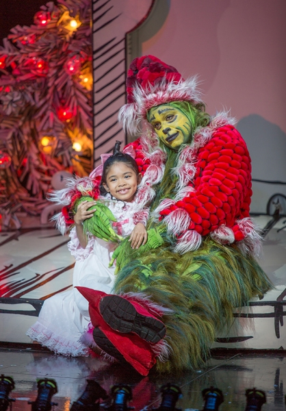 Mikee Castillo appears as Cindy-Lou Who and J. Bernard Calloway as The Grinch
