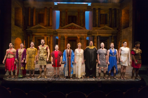 Christopher Fitzgerald (in red, fifth from left) as Pseudolus and the company of A FUNNY THING HAPPENED ON THE WAY TO THE FORUM at Two River Theater.