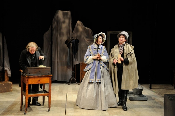 Stephen Berenson as Ebenezer Scrooge with Rachael Warren and Joshua Lomeli as solicitors for the poor