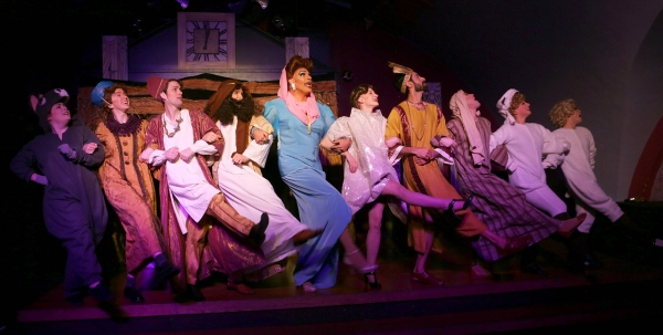 ''A Holiday Kickline'' - Joan Crawford (David Cerda, center) and the cast of  ''Oh Mary,'' the new MGM musical adaptation of the Virgin Mary''s close their opening number with a big Broadway kick-line