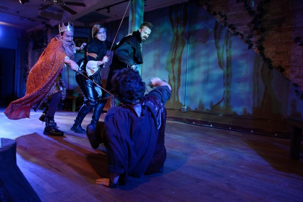 Andrew Bailes as ''Prince John,'' Christian Stokes as ''Sheriff of Nottingham,'' and Addison Heimann as ''Mercenary''; (on floor) Caleb Probst as ''Robin Hood''