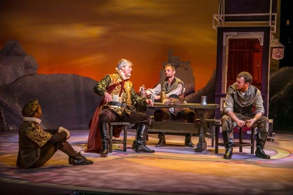 Sir John Falstaff plots with his compatriots Robin (Felix Mayes), Pistol (Jason Paul Tate), and Nym (Ryan McCarthy)