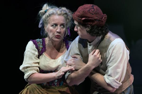 Mistress Quickly (Kristie Dale Sanders) and Peter Simple (Julian Gordon) exchange secrets