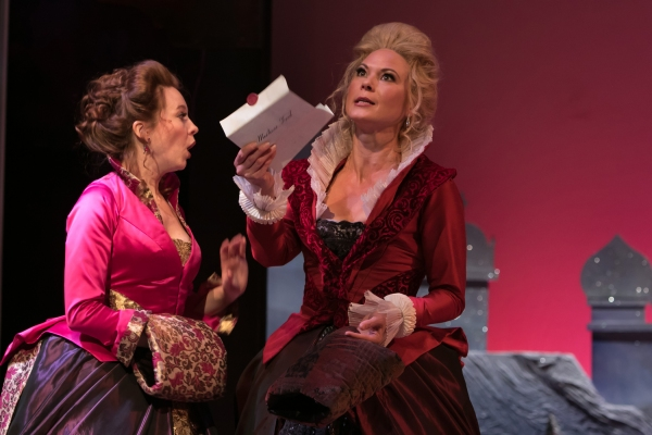 Mistress Margaret Page (Saluda Camp) and Mistress Alice Ford (Caralyn Kozlowski) begin planning their mischief