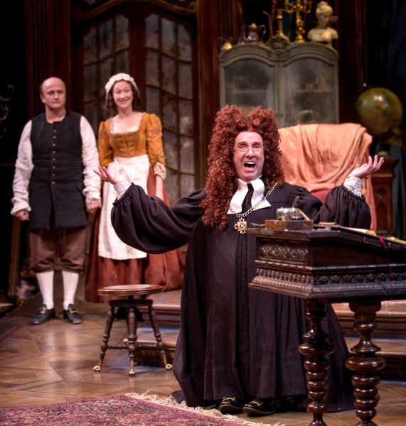 The diminutive lawyer Scruple (Patrick Kerr) is exasperated in penning Geronte''s will due to the high-jinks of servants Crispin (Cliff Saunders) and Lisette (Jessie Fisher).
